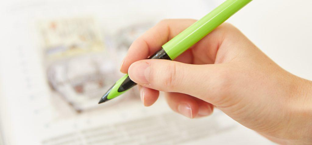 Hand mit Stift